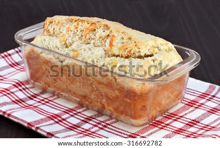 A fresh baked loaf of cheddar cheese bread.