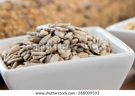 a fresh baked loaf of whole grains bread with poppy, flax and sunflower seeds - stock photo