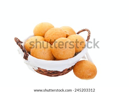 A fresh basket of golden brown hard crusted buns.  Shot on white background. - stock photo
