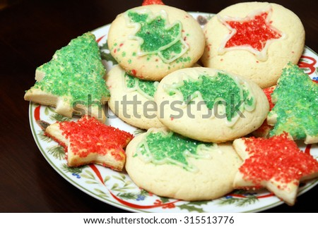 A fresh batch of Christmas cookies on a festive plate. - stock photo