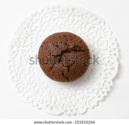 a fresh chocolate muffin (cake), top view - stock photo