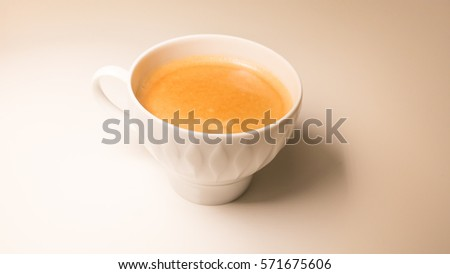 a fresh cup of coffee on a white table