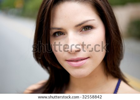 A Fresh Faced Girl With a beautiful face and green background