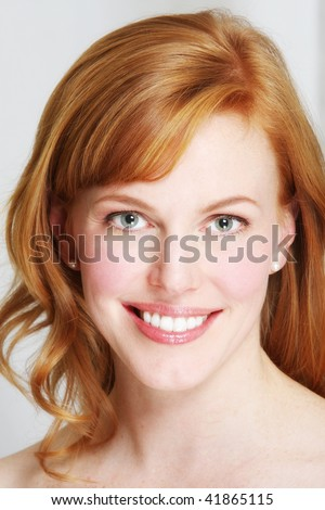 a fresh faced redhead with a beautiful smile - stock photo