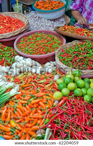A fresh food market stall situated in the town of Hua Hin in Thailand. - stock photo