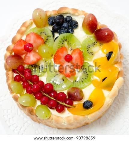 a fresh fruit and berry cake - a top view - stock photo