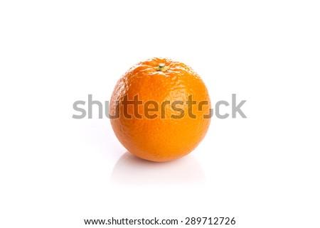 A fresh grapefruit(orange) isolated white reflected at the studio. - stock photo