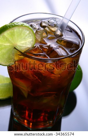 a fresh ice tea glass with lime - stock photo