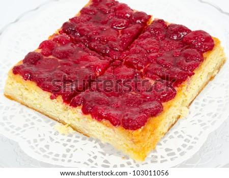 a fresh raspberry cheese cake - a closeup shot - stock photo