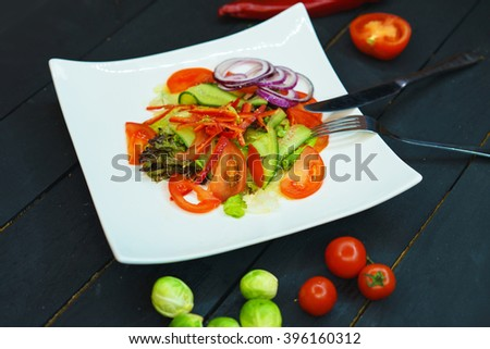A fresh salad. Fresh salad with vegetables on white plate. Salad vegetables. The salad vegetarian. - stock photo