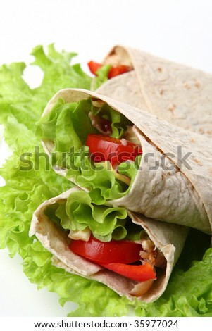 a fresh tortilla with peper and salad