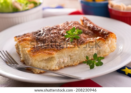 A freshly baked acadian rappie pie with grated potatoes and chicken.
