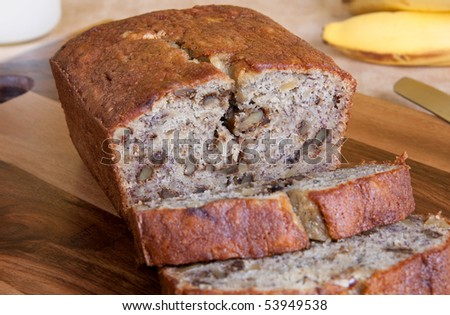 A freshly baked loaf of banana bread with walnuts. - stock photo