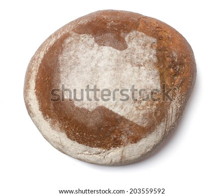 A freshly baked loaf of bread covered with rye flour in the shape of Libya.(series) - stock photo