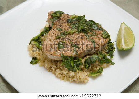 A freshly cooked lamb steak with fresh mint, cous cous and lime - stock photo