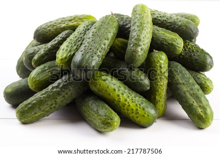 A freshly cucumbers on woodboard
