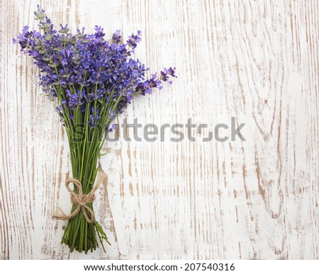 A freshly cut bunch of Lavender, on a rustic white bench - stock photo