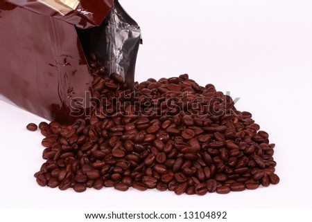 A freshly spilled bag of Colombian coffee beans. - stock photo