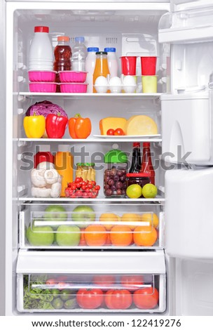 A fridge full of healthy products - stock photo