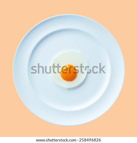 a fried egg on white dish cream background - stock photo
