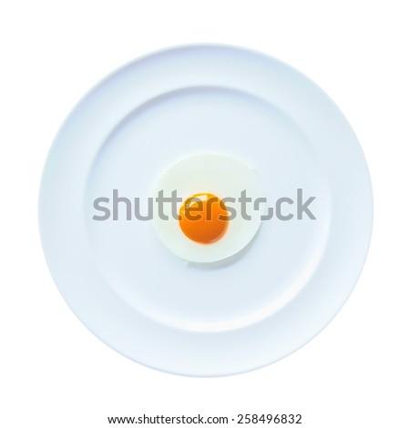 a fried egg on white dish isolate white background - stock photo