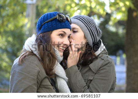 a friend tells a secret friend - stock photo