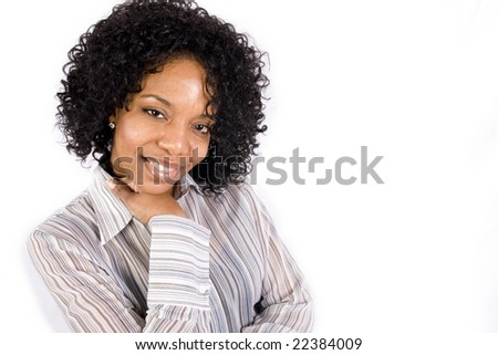 A friendly African American girl smiles at the camera in front of a white background