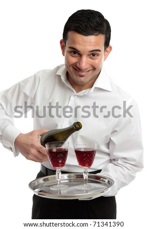 A friendly hospitality smile as a waiter or servant pours wine. - stock photo