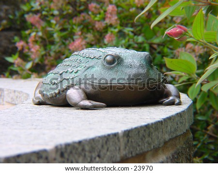 A frog statue at the San Francisco zoo. - stock photo
