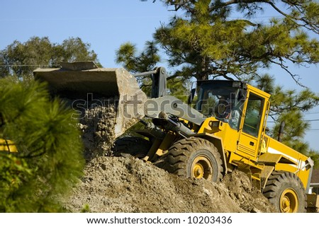 A front-end loader at work moving dirt