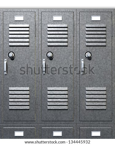 A front on view of a stack of grey metal school lockers with combination locks and doors shut on an isolated background