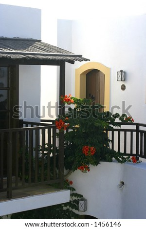 A front verandah of a mediterranean hotel accomodation - stock photo