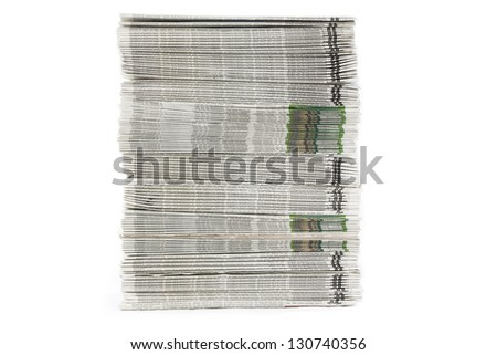A frontal view of neatly stacked freshly printed newspapers - stock photo