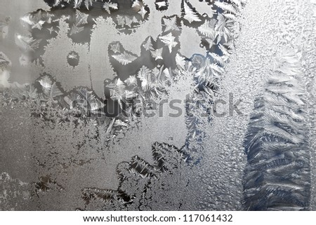 a frosted glass surface background taken  in cold winter weather from inside of building