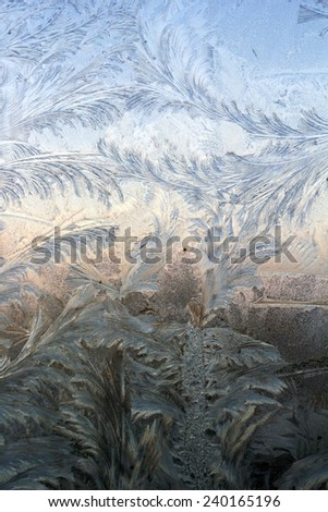 a frosted glass surface background taken in cold winter weather from inside of building - stock photo