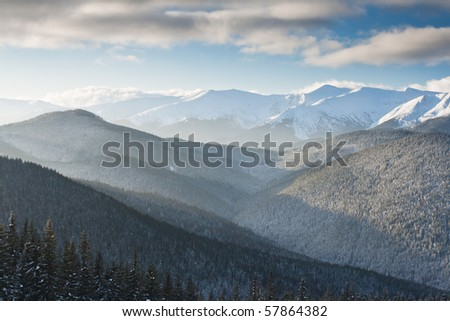A frosty day is in mountains - stock photo
