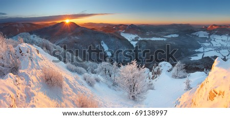 A frosty sunset panorama in beauty winter mountains - stock photo