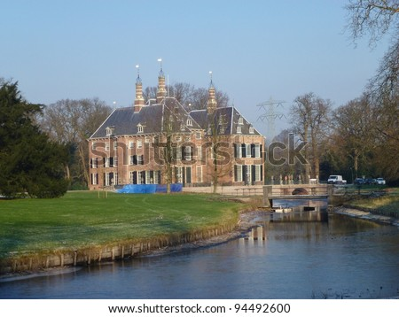 A frozen canal with the Duivenvoorde castle in Voorschoten in the Netherlands