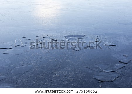 A frozen surface. An image of a frozen lake with thin ice. - stock photo