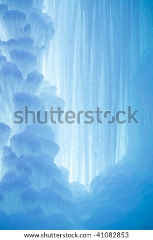 A frozen waterfall with ice in a blue and white color in winter - stock photo