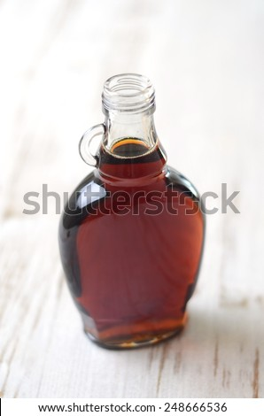 A full bottle of real maple syrup - stock photo