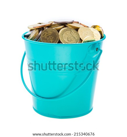 a full bucket of coins on white background - stock photo