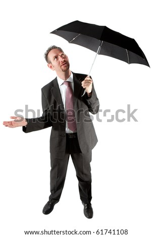 A full length of a mid thirties business man.  The man is standing underneath a black umbrella and checking if it raining.  Studio isolated on a white background. - stock photo