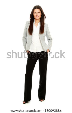 A full length portrait of a beautiful businesswoman standing - stock photo