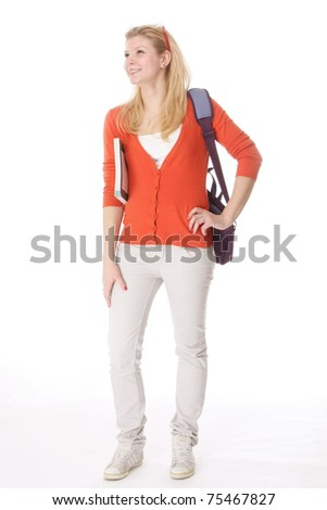 A full-length portrait of a young college girl with books - stock photo