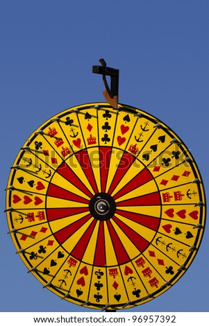 "A full view photo of a Crown and Anchor ""Wheel of Fortune"" game. - stock photo"