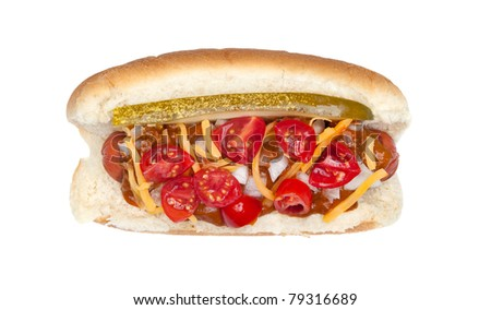 A fully loaded New Your style hotdog with pickles, onions, cheese, chile and tomato slices isolated on white