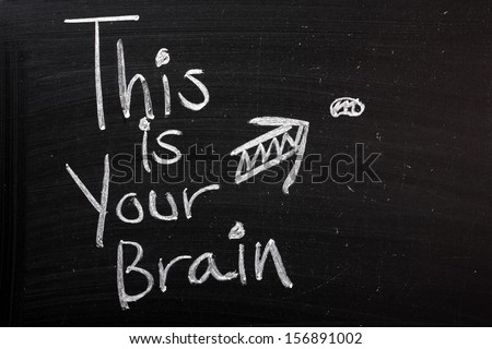 A funny comment, This is Your Brain with an arrow pointing to a tiny brain on a blackboard. - stock photo