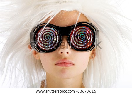 A funny looking kid with crazy white hair and wild hypnotic glasses. - stock photo