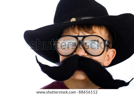 A funny young boy in a cowboy costume. - stock photo